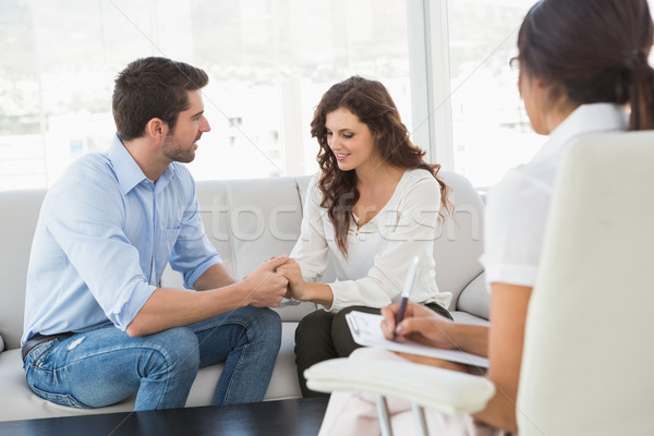 Stock photo: Reconciled couple smiling at each other
