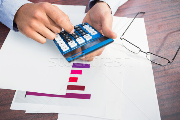 Close up of finger using calculator at desk Stock photo © wavebreak_media