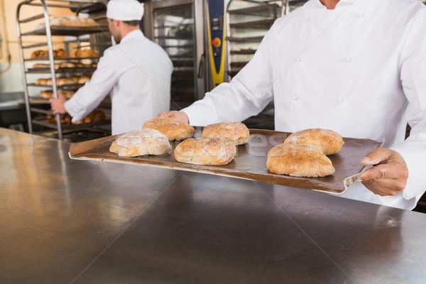 Közelkép pék tart tálca kenyér konyha Stock fotó © wavebreak_media