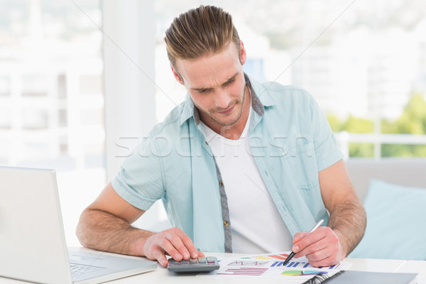 Casual businessman working with calculator  Stock photo © wavebreak_media
