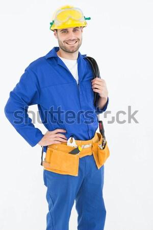 Happy construction worker standing with hand on hip Stock photo © wavebreak_media