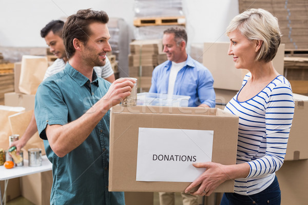 Kettő önkéntesek tart adományok doboz nagy Stock fotó © wavebreak_media
