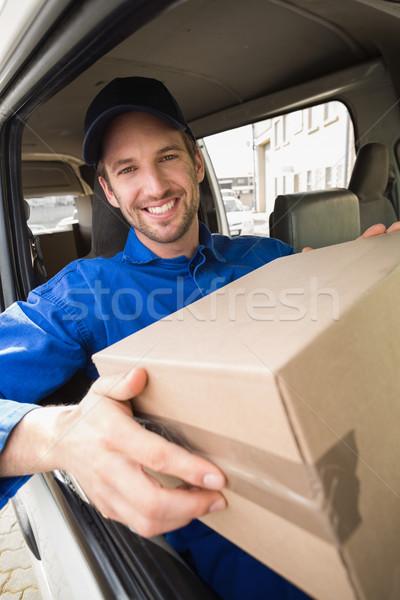 Delivery driver holding parcel in his van Stock photo © wavebreak_media