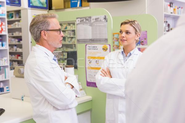 Cheerful team of pharmacist talking together Stock photo © wavebreak_media