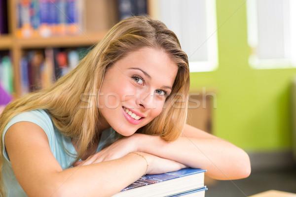Portré női diák könyvtár ül könyvek Stock fotó © wavebreak_media