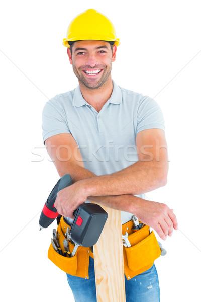 Sorridere maschio falegname potere trapano Foto d'archivio © wavebreak_media