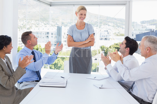 Business team applauding their colleague Stock photo © wavebreak_media