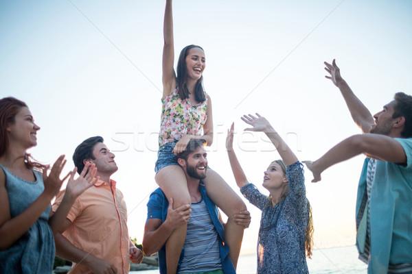 Happy friends dancing on the sand Stock photo © wavebreak_media