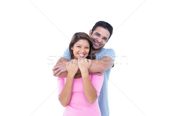 Boldog pár átkarol néz kamera fehér Stock fotó © wavebreak_media