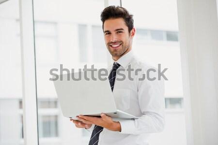 Portré mosolyog technikus tart laptop dől Stock fotó © wavebreak_media