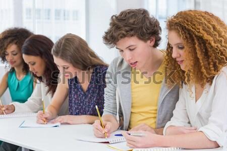 Smiling friends sitting studying together  Stock photo © wavebreak_media