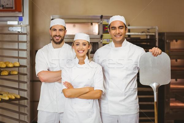 équipe souriant caméra commerciaux cuisine restaurant Photo stock © wavebreak_media