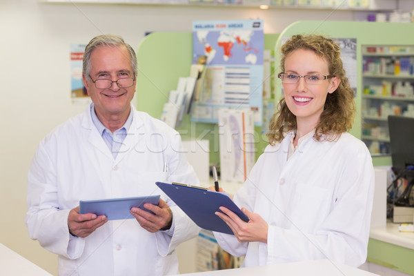 Team of pharmacists smiling at camera Stock photo © wavebreak_media