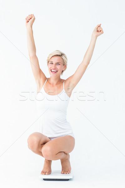 Gelukkig aantrekkelijke vrouw hurken schalen witte succes Stockfoto © wavebreak_media