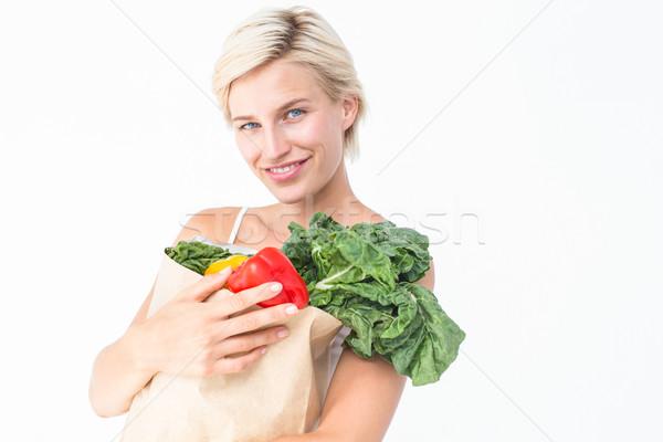 Mujer atractiva bolsa hortalizas blanco papel Foto stock © wavebreak_media