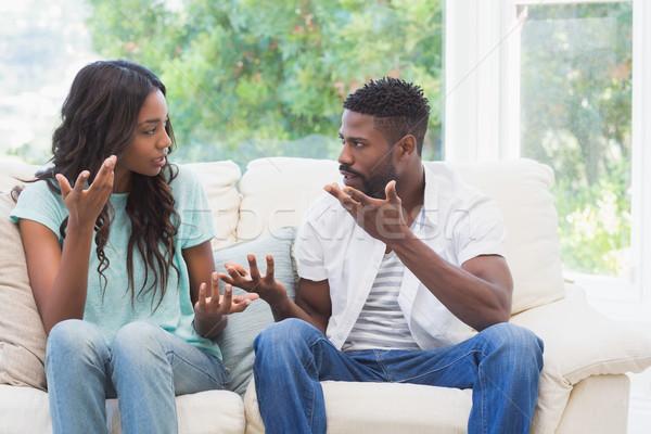 Couple having argument on the couch Stock photo © wavebreak_media