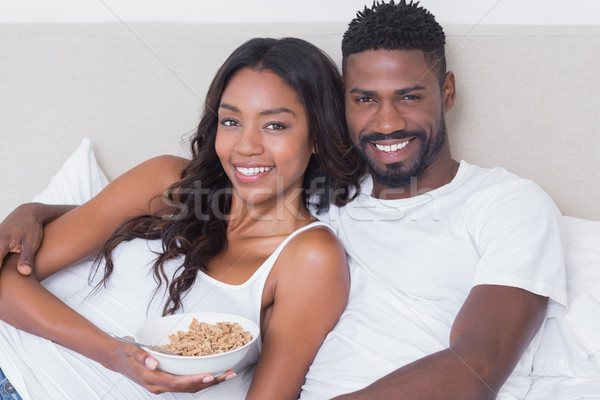 Casal cama juntos alimentação cereal Foto stock © wavebreak_media