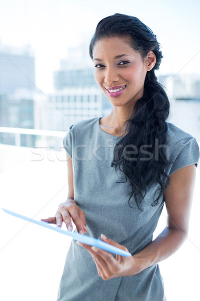 Focused businesswoman using digital tablet Stock photo © wavebreak_media