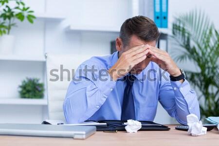 Businessman with severe headache holding his head Stock photo © wavebreak_media