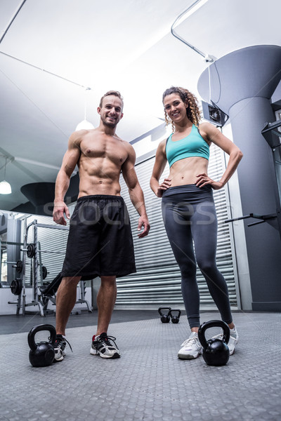 Muscular couple looking at the camera Stock photo © wavebreak_media