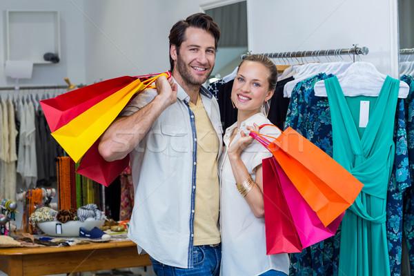 Sorridente casal roupa armazenar homem Foto stock © wavebreak_media