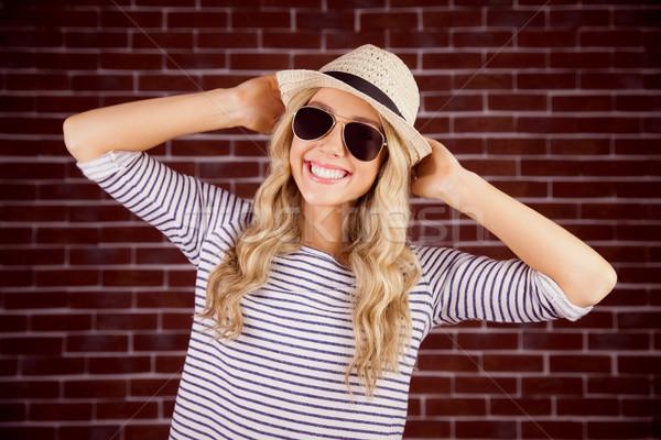 великолепный улыбаясь блондинка позируют соломенной шляпе Сток-фото © wavebreak_media