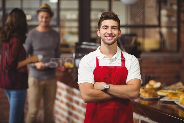 Handsome waiter with arms crossed Stock photo © wavebreak_media