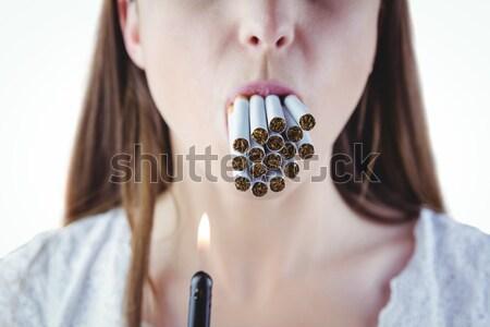Afbeelding vrouw verlichting veel sigaretten Stockfoto © wavebreak_media
