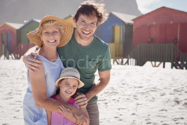 Portrait of multi-generation family embracing at beach Stock photo © wavebreak_media