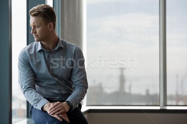 Thoughtful executive looking through window Stock photo © wavebreak_media