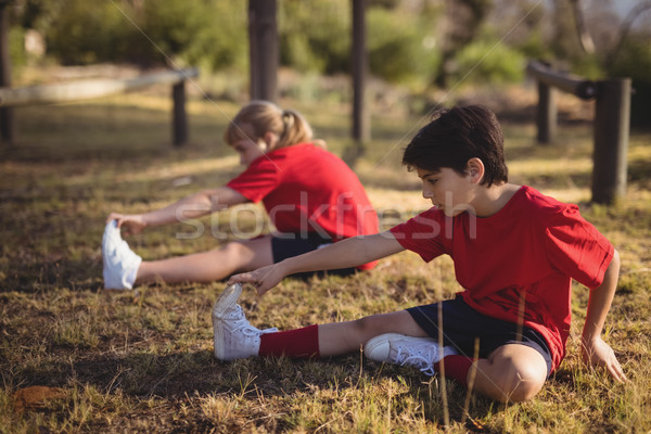 Kids performing stretching exercise during obstacle course Stock photo © wavebreak_media