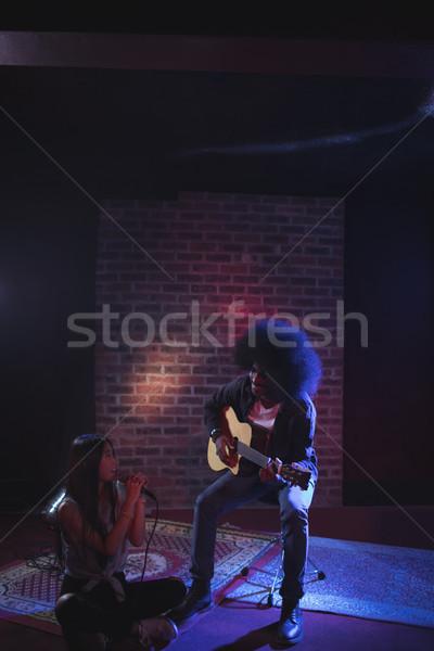Female singer with guitarist practicing in nightclub Stock photo © wavebreak_media