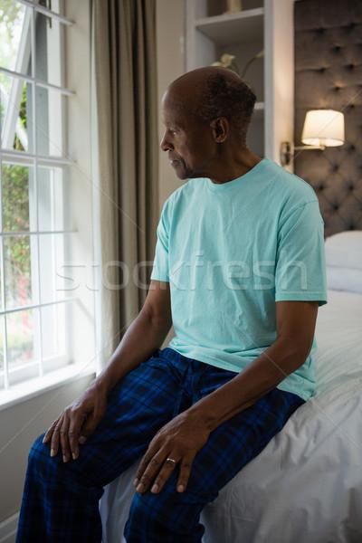 Figyelmes idős férfi ül ágy ablak Stock fotó © wavebreak_media