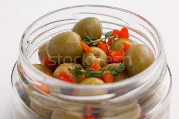 Close up of green olives with herbs in jar Stock photo © wavebreak_media