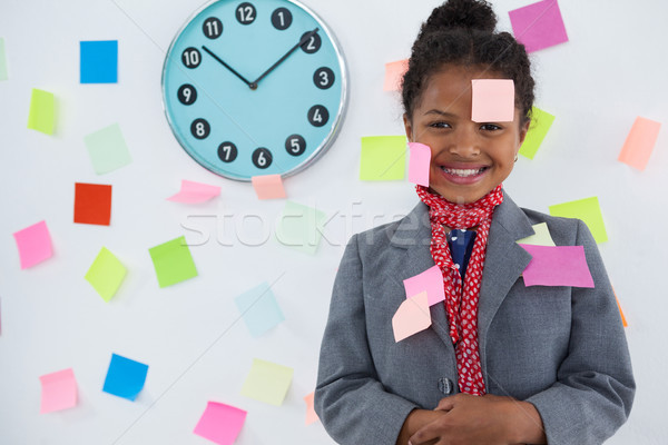 smiling businesswoman with adhesive notes stuck on suit and head Stock photo © wavebreak_media