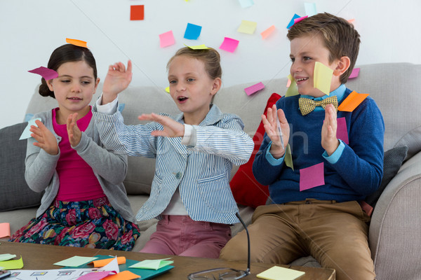 Kids as business executives playing with sticky notes Stock photo © wavebreak_media