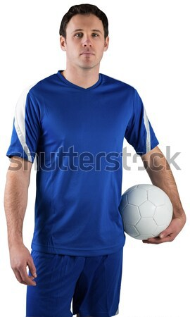 Stock photo: Rugby player holding a rugby ball