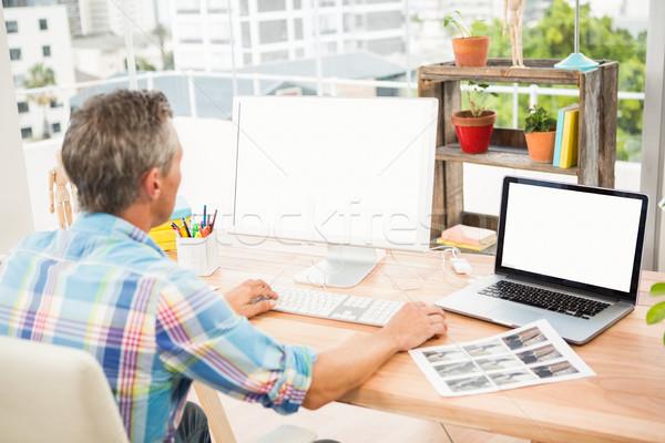 Casual designer working on computer Stock photo © wavebreak_media