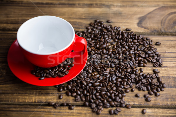 Coffee beans on a table with cup Stock photo © wavebreak_media