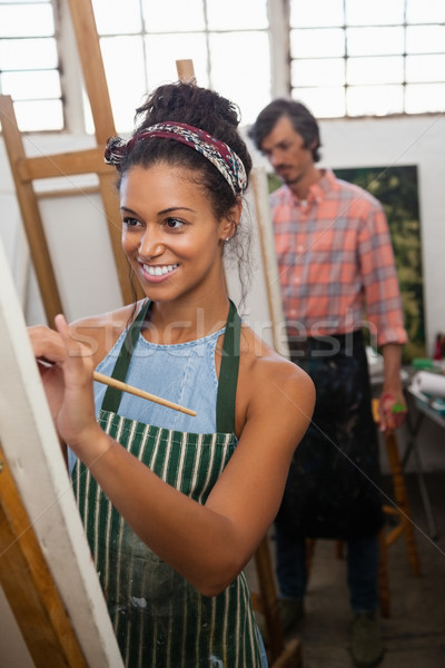 Man and woman painting on canvas Stock photo © wavebreak_media
