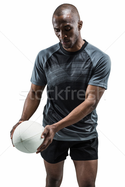 Athlete looking at rugby ball Stock photo © wavebreak_media