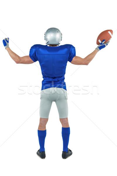 Teljes alakos hátsó nézet amerikai futballista tart labda Stock fotó © wavebreak_media