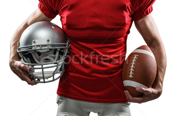 Midsection of American football player in red jersey holding hel Stock photo © wavebreak_media