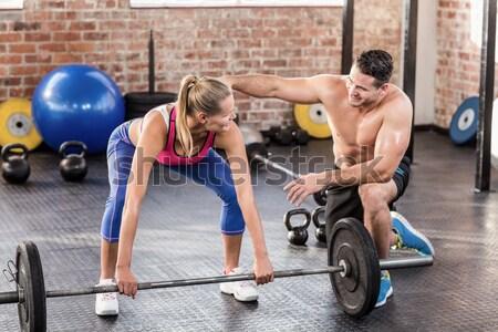 Emberek emel súlyzó tornaterem férfi fitnessz Stock fotó © wavebreak_media