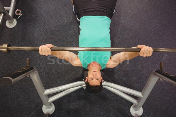 Fit man lifting heavy barbell Stock photo © wavebreak_media