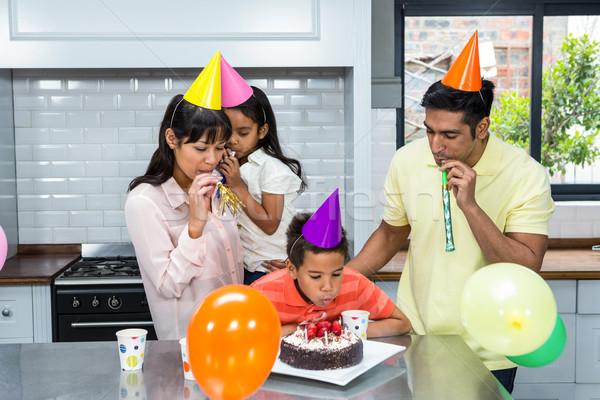 Happy family celebrating a birthday Stock photo © wavebreak_media
