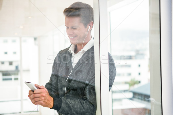 Close-up of man using mobile phone at office Stock photo © wavebreak_media