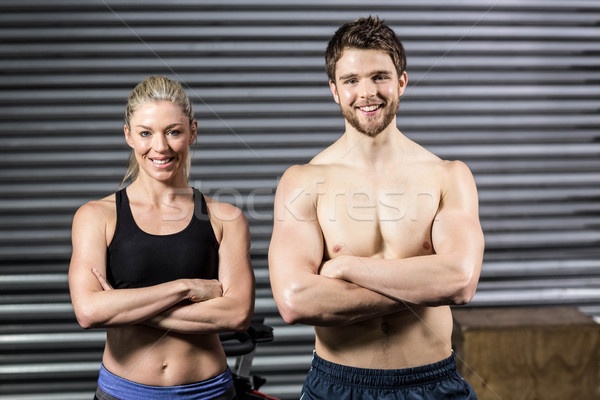 Crossfit couple smilling at the camera Stock photo © wavebreak_media