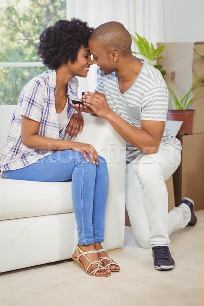 Yakışıklı adam teklif kız arkadaş oturma odası kadın Stok fotoğraf © wavebreak_media