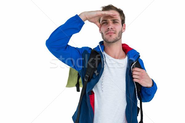 Backpacker zoeken iets witte hand man Stockfoto © wavebreak_media